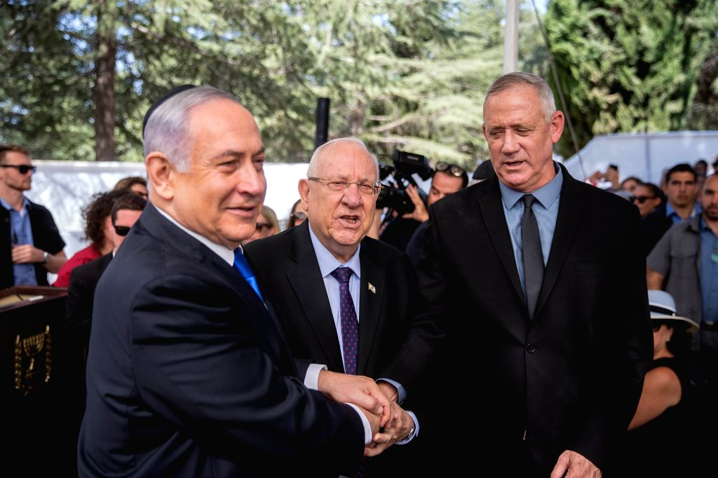 JERUSALEM, Sept. 19, 2019 (Xinhua) -- Israeli Prime Minister Benjamin Netanyahu (L), Israeli President Reuven Rivlin (C) and Blue and White party leader Benny Gantz attend a memorial service for late Israeli president Shimon Peres in Jerusalem, on Se - Benjamin Netanyahu