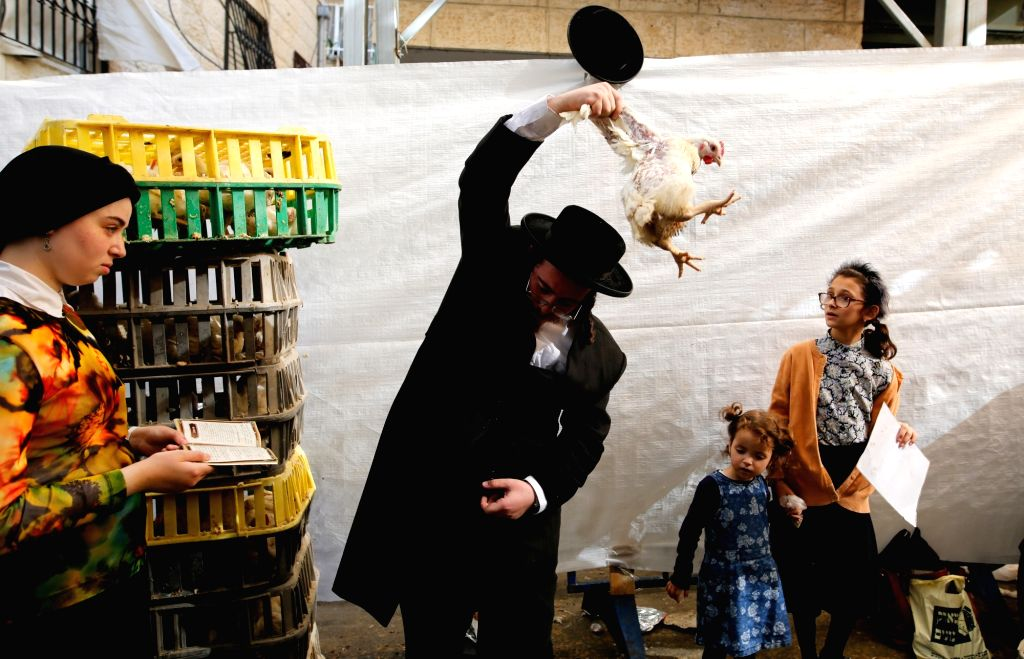 JERUSALEM, Sept. 27, 2017 - A ultra-Orthodox Jews perform the traditional Kaparot ceremony in Jerusalem, on Sept. 27, 2017. It is customary to perform the Kaparot ceremony in preparation for Yom ...