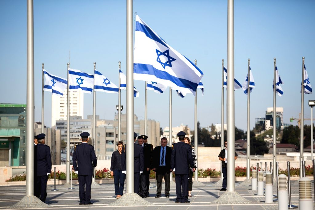 JERUSALEM, Sept. 28, 2016 - Members of Knesset Honor Guard lower the Israeli flag at half-mast during a ceremony in memory of former Israeli President Shimon Peres at the Knesset, the Israeli ...