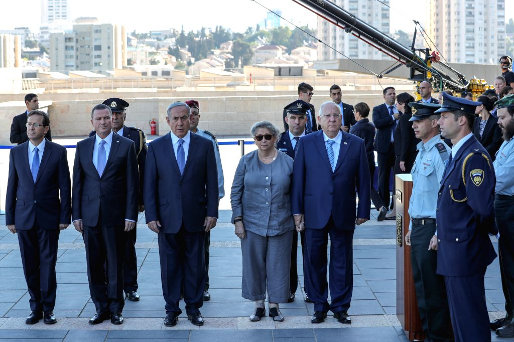 JERUSALEM, Sept. 29, 2016 - Israeli Prime Minister Benjamin Netanyahu (3rd L, front) and President Reuven Rivlin (5th L, front) stand near the coffin of former Israeli President Shimon Peres at the ... - Benjamin Netanyahu