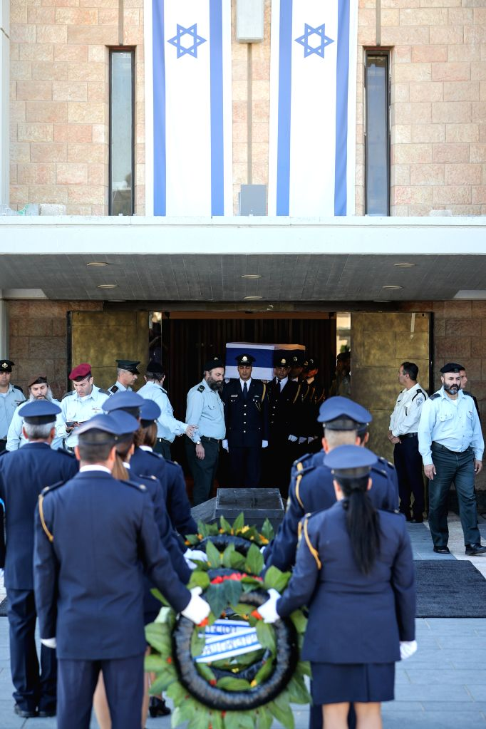 JERUSALEM, Sept. 29, 2016 - Members of the honor guard carry the coffin of former Israeli President Shimon Peres to the central Knesset plaza in Jerusalem, Sept. 29, 2016. Peres, one of the last ...