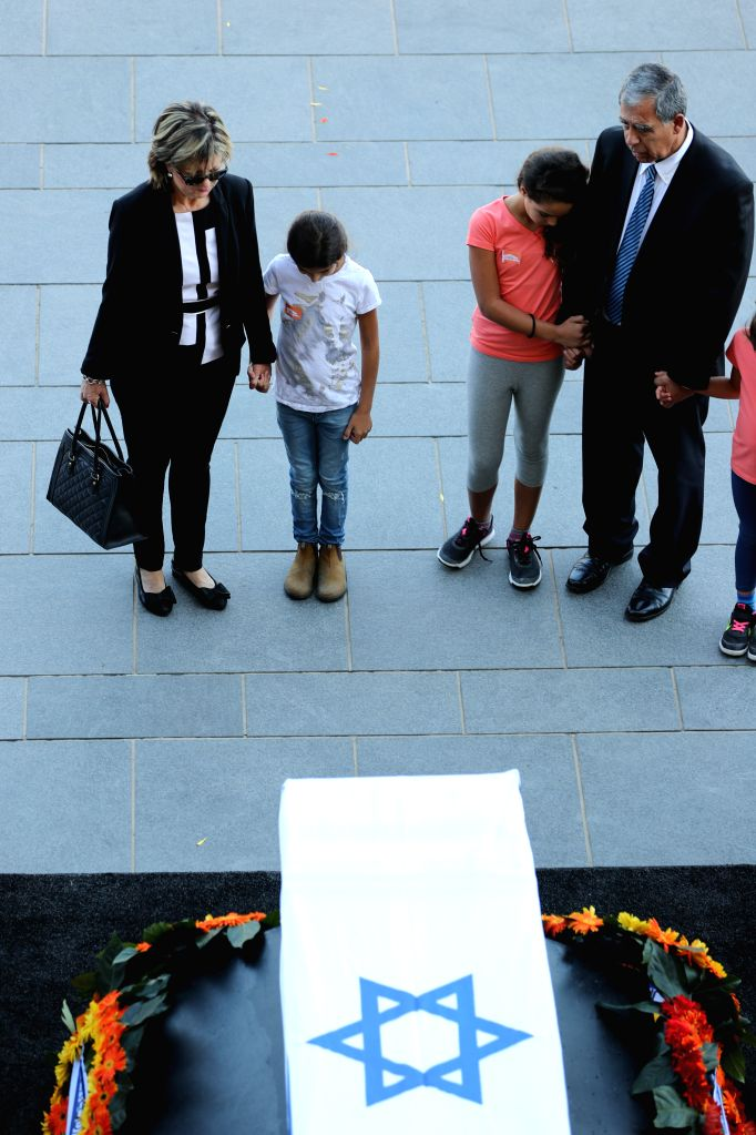 JERUSALEM, Sept. 29, 2016 - People pay their last respect in front of the coffin of former Israeli President Shimon Peres at the central Knesset plaza in Jerusalem, Sept. 29, 2016. Peres, one of the ...