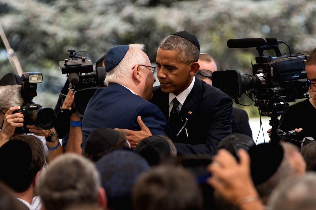 JERUSALEM, Sept. 30, 2016 - U.S. President Barack Obama (R) hugs Israeli President Reuven Rivlin after delivering a eulogy during the funeral of Israel's former president Shimon Peres at Mount Herzl ...