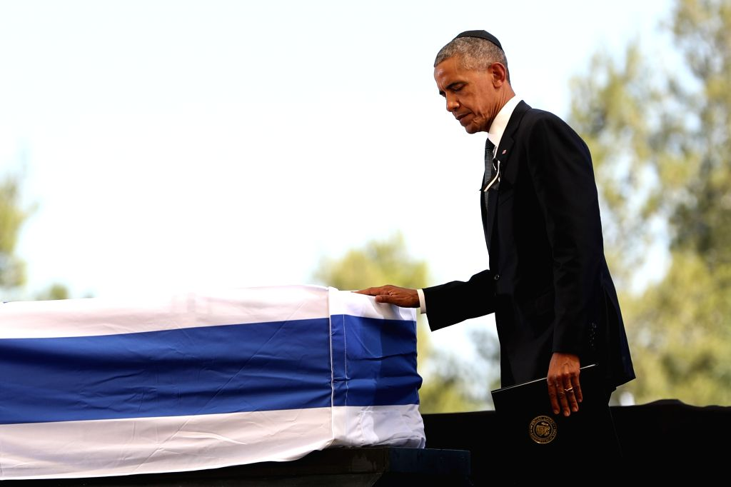 JERUSALEM, Sept. 30, 2016 - U.S. President Barack Obama pays his respect to the coffin of Israel's former president Shimon Peres during his funeral at Mount Herzl cemetery in Jerusalem, Sept. 30, ...