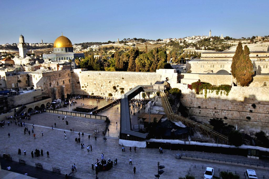 """A general view shows a wooden pedestrian bridge (bottom) connecting the Western Wall compound and the compound, known to Muslims as the """"Noble ..."""