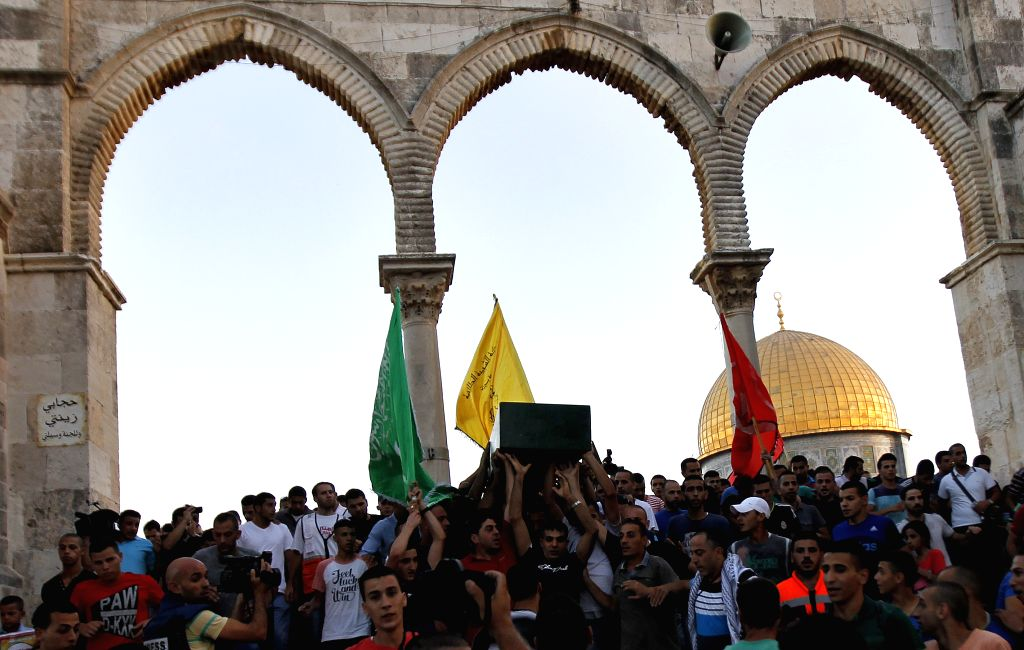 Palestinians carry the coffin of Muhammad Abd al-Majid Sunuqrut during his funeral in front of the Dome of the Rock on the compound, known to Muslims as the ...