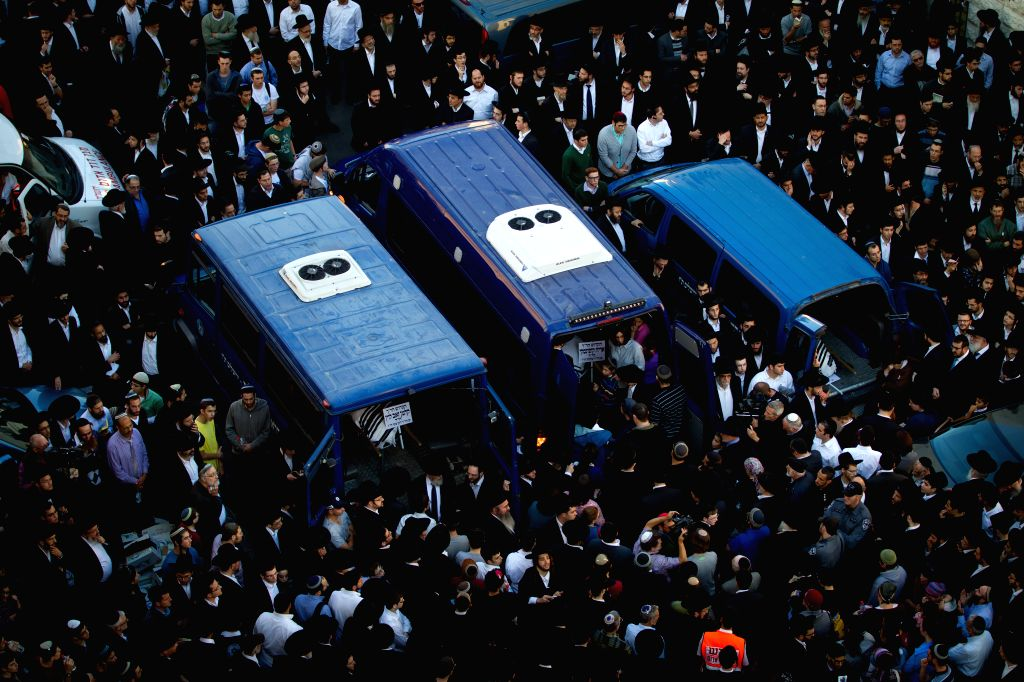 The bodies of Aryeh Kopinsky (C), Calman Levine (L) and Avraham Shmuel Goldberg are seen in vehicles during a funeral near the scene of the attack at a synagogue in the Har Nof ... - Benjamin Netanyahu