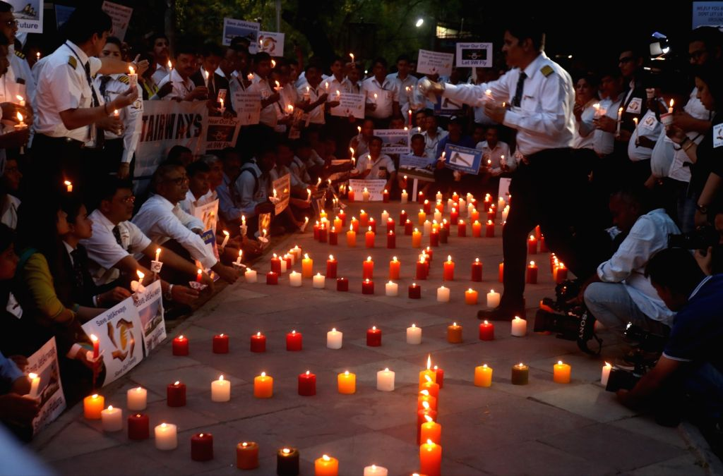 Jet Airways employees participate in a candle light march to protest against the company in New Delhi on April 27, 2019.