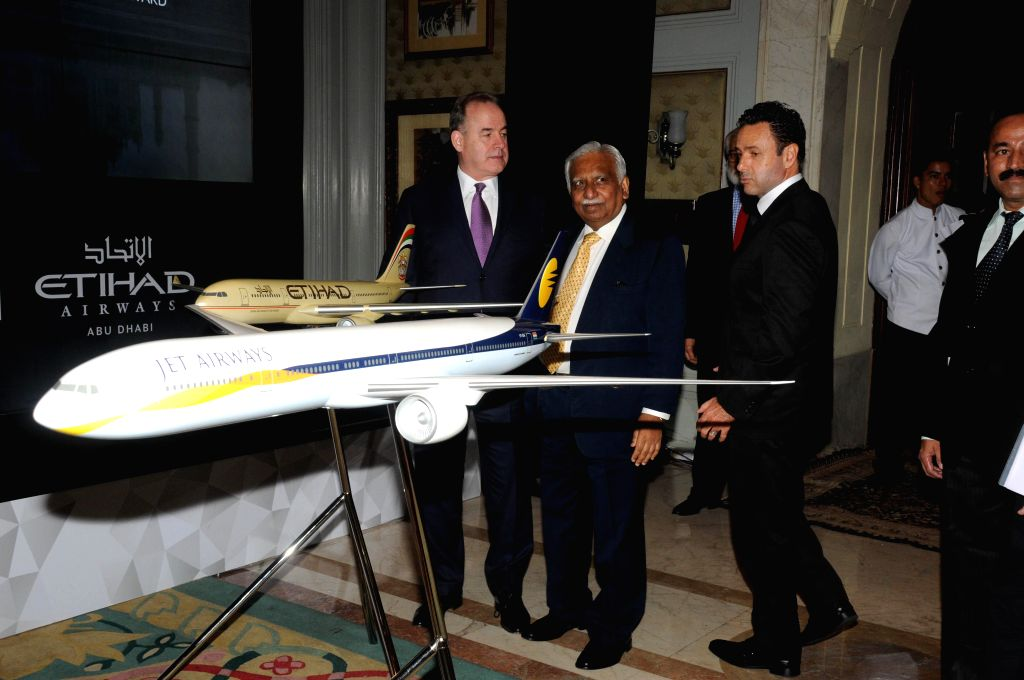 Jet Airways (India) Ltd CEO Cramer Bell, Jet Airways' Chairman Naresh Goyal and Etihad Airways President and CEO James Hogan during a joint press conference of Jet Airways and Etihad Airways in New ..