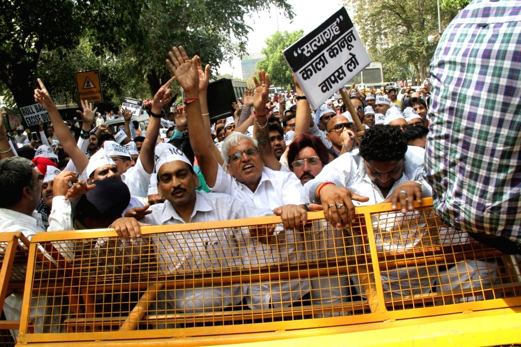 Jewellers stage a protest against the one percent excise duty proposed by Finance Minister Arun Jaitley in the 2016-17 national budget, outside BJP headquarters in New Delhi, on March 29, ... - Arun Jaitley
