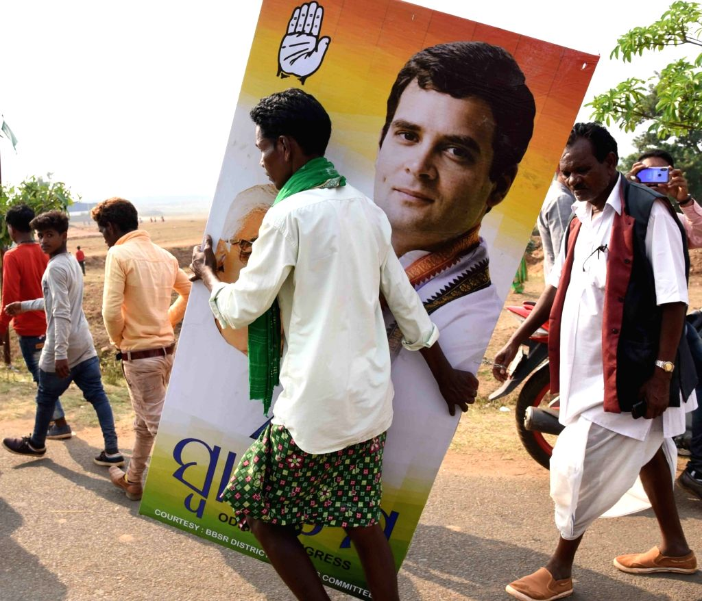 Jeypore (Odisha): A man caries a cut out of Congress President Rahul Gandhi at the venue of party rally Odisha, on March 8, 2019. - Rahul Gandhi