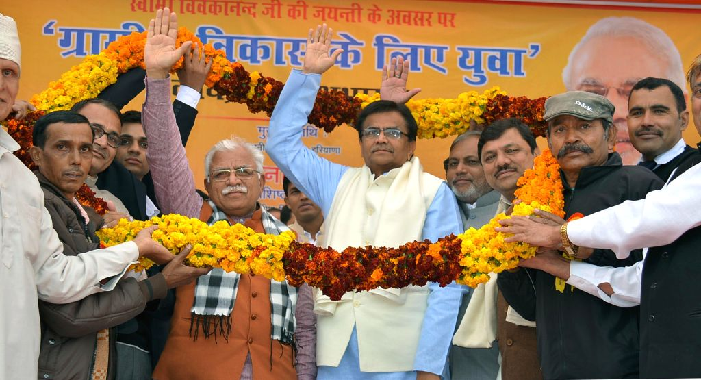 Haryana Chief Minister Manohar Lal Khattar, Haryana Agriculture Minister O.P. Dhankar and Haryana Minister of State for Cooperation Bikram Singh Yadav during a programme organised ​to ... - Manohar Lal Khattar and Bikram Singh Yadav