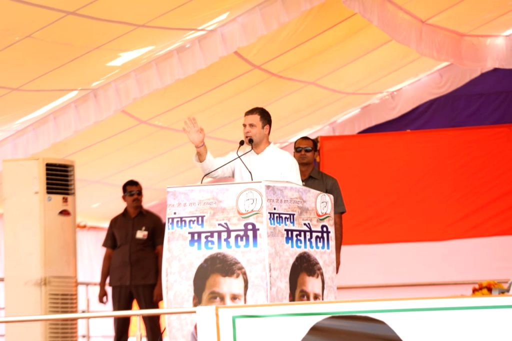:Jhalawar: Congress President Rahul Gandhi waves to supporters during a public rally in Jhalawar, Rajasthan, on Oct 24, 2018. (Photo: IANS).