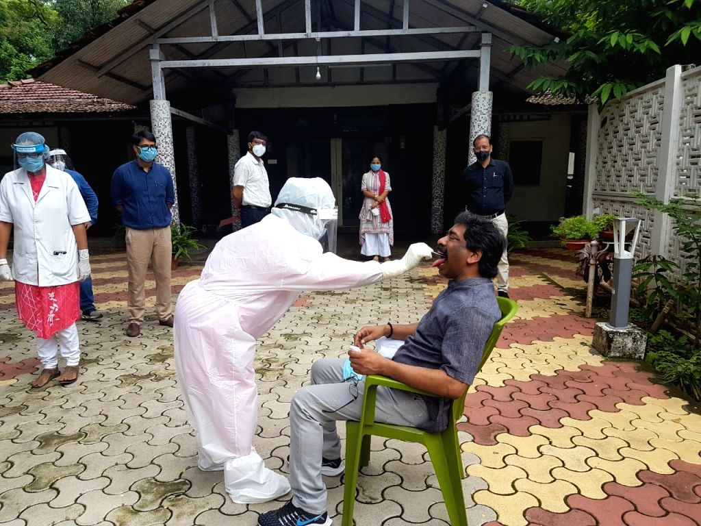 Jharkhand Chief Minister Hemant Soren gives swab samples for COVID-19 testing, in Ranchi on July 11, 2020. Hemant Soren, along with his family members, underwent the Covid-19 test on Saturday ... - Hemant Soren
