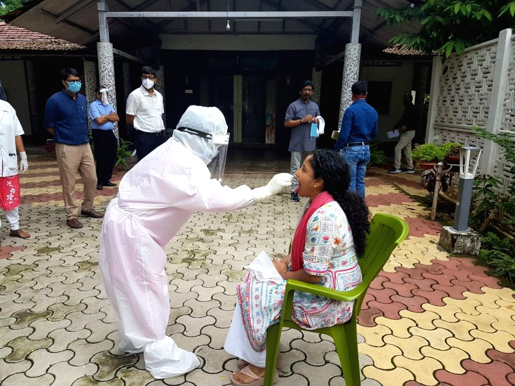 Jharkhand Chief Minister Hemant Soren's wife gives swab samples for COVID-19 testing, in Ranchi on July 11, 2020. Jharkhand CM Hemant Soren, along with his family members, underwent the ... - Hemant Sore
