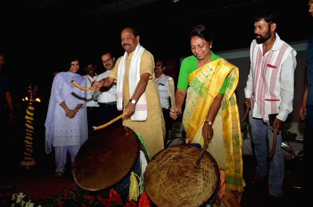 "Jharkhand Chief Minister Raghubar Das along with state minister Louis Marandi play drum or 'Nagada' during ""World Tribal Day"" celebrations, in Ranchi on Aug 9, 2018. - Raghubar Das"