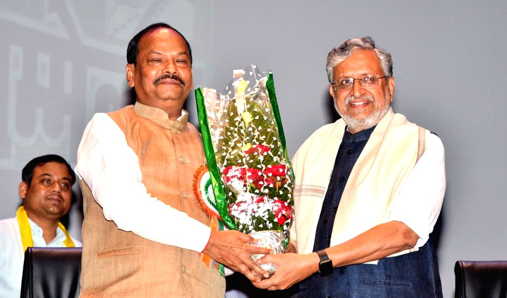 Jharkhand Chief Minister Raghubar Das and Bihar Deputy Chief Minister Sushil Kumar Modi during a programme in Patna on Aug 5, 2018. - Raghubar Das and Sushil Kumar Modi