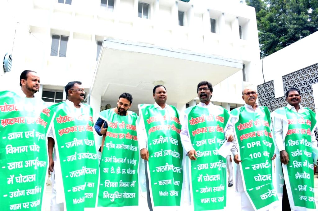 Jharkhand Mukti Morcha (JMM) legislators led by er of Opposition and party's Executive President Hemant Soren stage a demonstration against the state government over corruption and ...