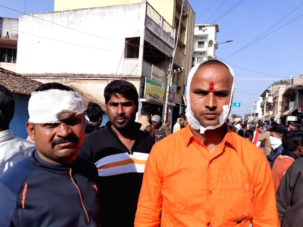 Jharkhand: Two of the several persons who were injured after stones were pelted allegedly from inside a mosque on a rally taken out by the Vishva Hindu Parishad (VHP) in support of the Citizenship Amendment Act (CAA) 2019 in Jharkhand. (Photo: IANS)