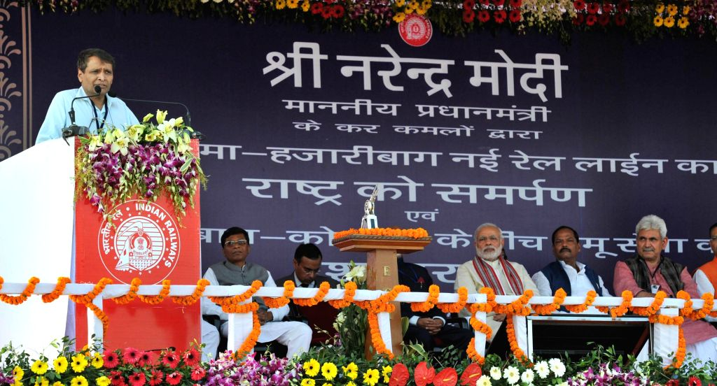 Union Minister for Railways Suresh Prabhakar Prabhu addresses during the inauguration of the New Railway Line between Hazaribag and Kodarma, in Jharkhand on Feb 20, 2015. Also seen Prime ... - Narendra Modi