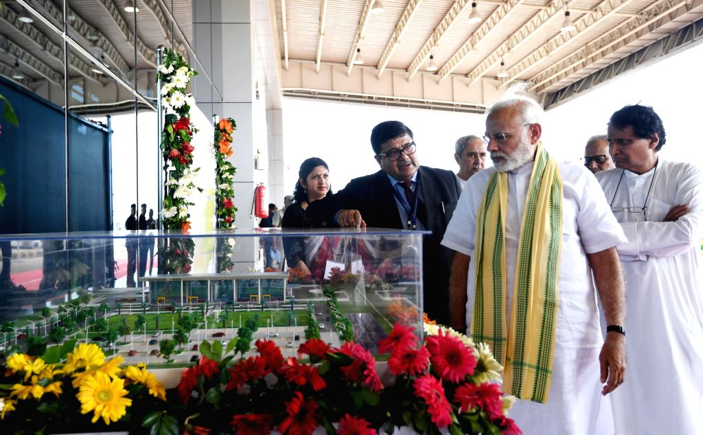 Jharsuguda: Prime Minister Narendra Modi with Odisha Chief Minister Naveen Patnaik and Union Civil Aviation Minister Suresh Prabhakar Prabhu at the inauguration of the Jharsuguda airport, in Odisha on Sept 22, 2018. (Photo: IANS/PIB) - Narendra Modi and Suresh Prabhakar Prabhu