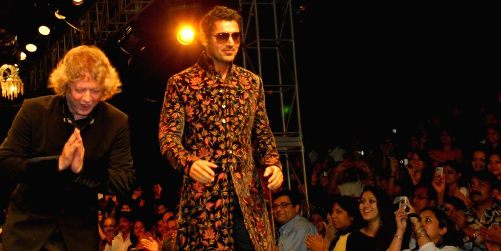 Jhon Abraham walks the runway for designer Rohit Bal show during the Kolkata Fashion Week on 5th Apr 2009, India.