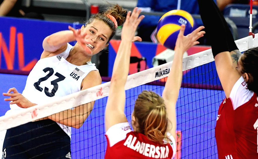 JIANGMEN, June 12, 2019 - Kelsey Robinson (L) of the United States spikes the ball during the 2019 FIVB women's volleyball nations league between the United States and Poland, in Jiangmen, south ...