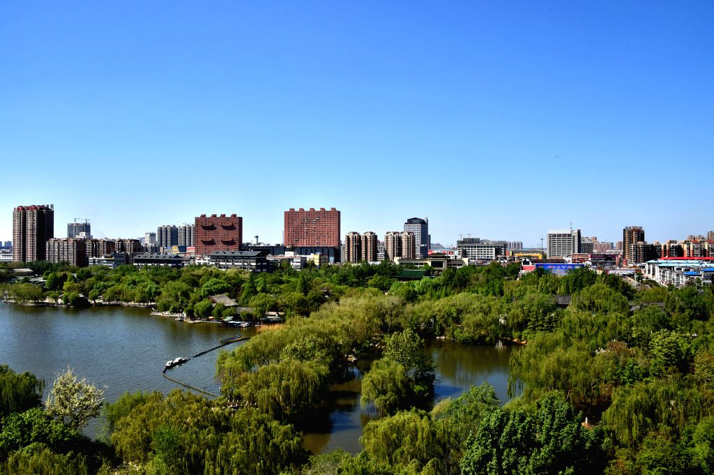 JINAN, April 18, 2016 - Photo taken on April 18, 2016 shows the clear sky over downtown Jinan, capital of east China's Shandong Province, after rainfall. (Xinhua/Xu Suhui)