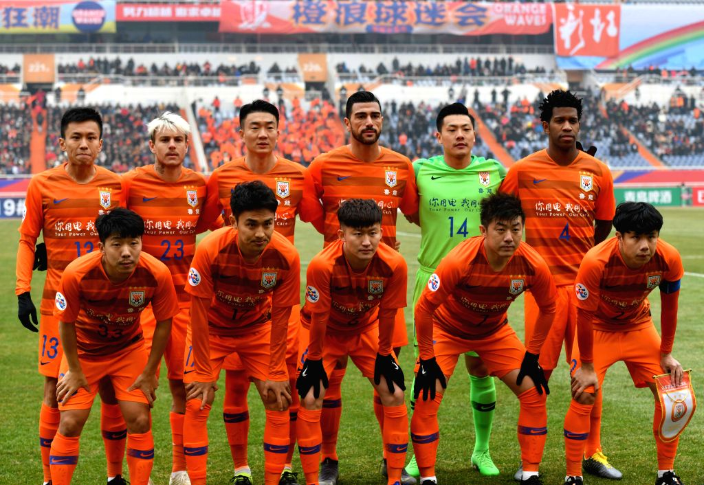 JINAN, Feb. 19, 2019 - Shandong Luneng's starting players pose prior to the play-off stage match between China's Shandong Luneng and Vietnam's Hanoi FC of the AFC Champions League in Jinan, capital ...