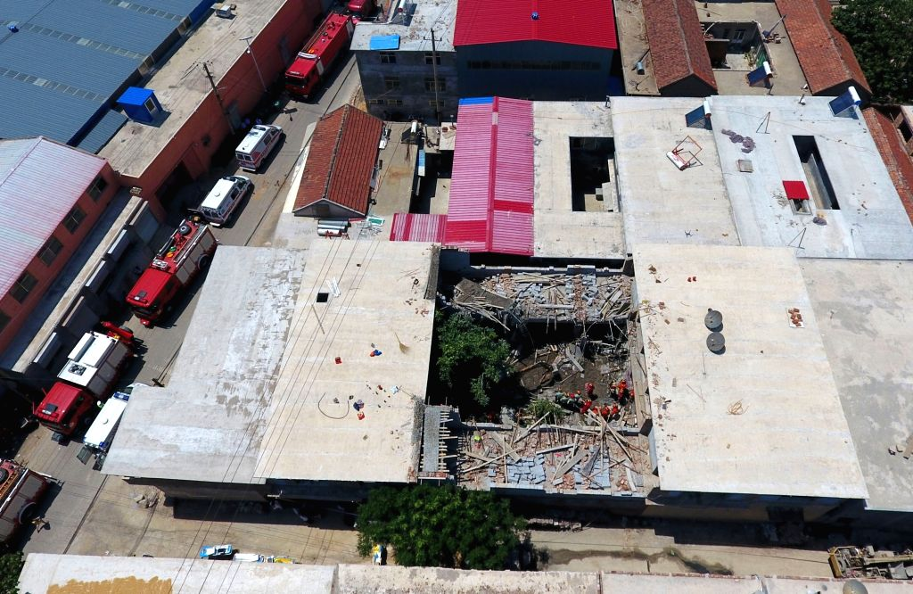 JINAN, May 27, 2017 - Photo taken on May 27, 2017 shows a building collapse site in Shizhong District of Jinan, capital of east China's Shandong Province. Six people were killed and four injured ...