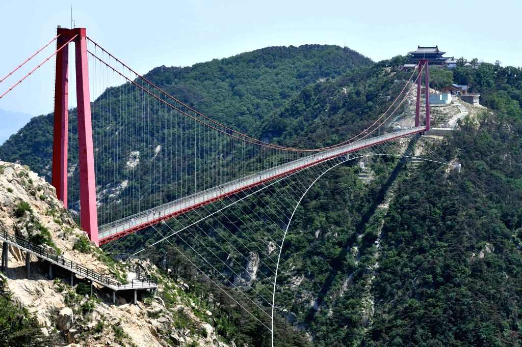 JINAN, May 28, 2017 - Photo taken on May 27, 2017 shows a general view of the glass suspension bridge in Yimeng Mountains in Feixian County, east China's Shandong Province. The 505.5-meter-long glass ...