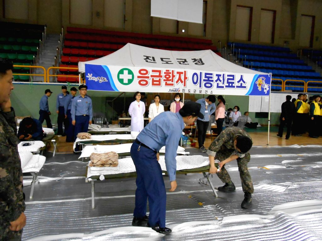 Workers prepare beds for missing passengers's relatives in Jindo, South Korea. A passenger ship with 462 people aboard, mostly high school students, sank in waters ..