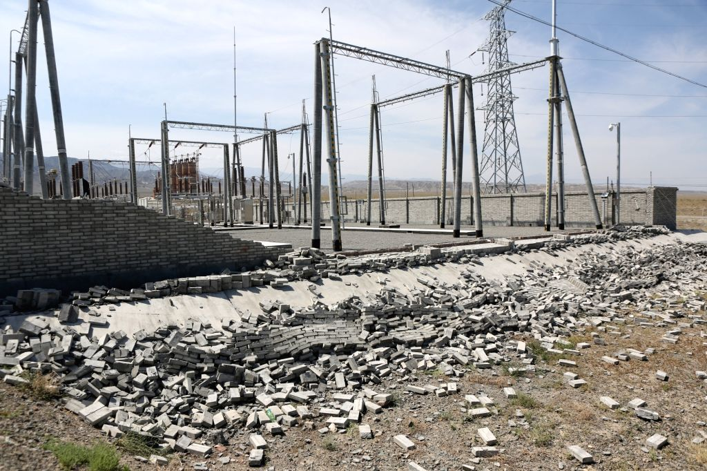 JINGHE, Aug. 9, 2017 - A wall falls at the Gezhou 110kv Substation in Bajiahu Village of Jinghe County, northwest China's Xinjiang Uygur Autonomous Region, Aug. 9, 2017. Power supply was not affected ...