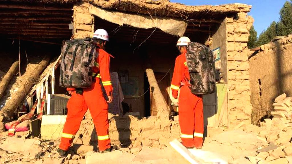JINGHE, Aug. 9, 2017 - Rescuers check a house damaged in earthquake in Jinghe County, northwest China's Xinjiang Uygur Autonomous Region, Aug. 9, 2017. A 6.6-magnitude earthquake jolted Jinghe County ...