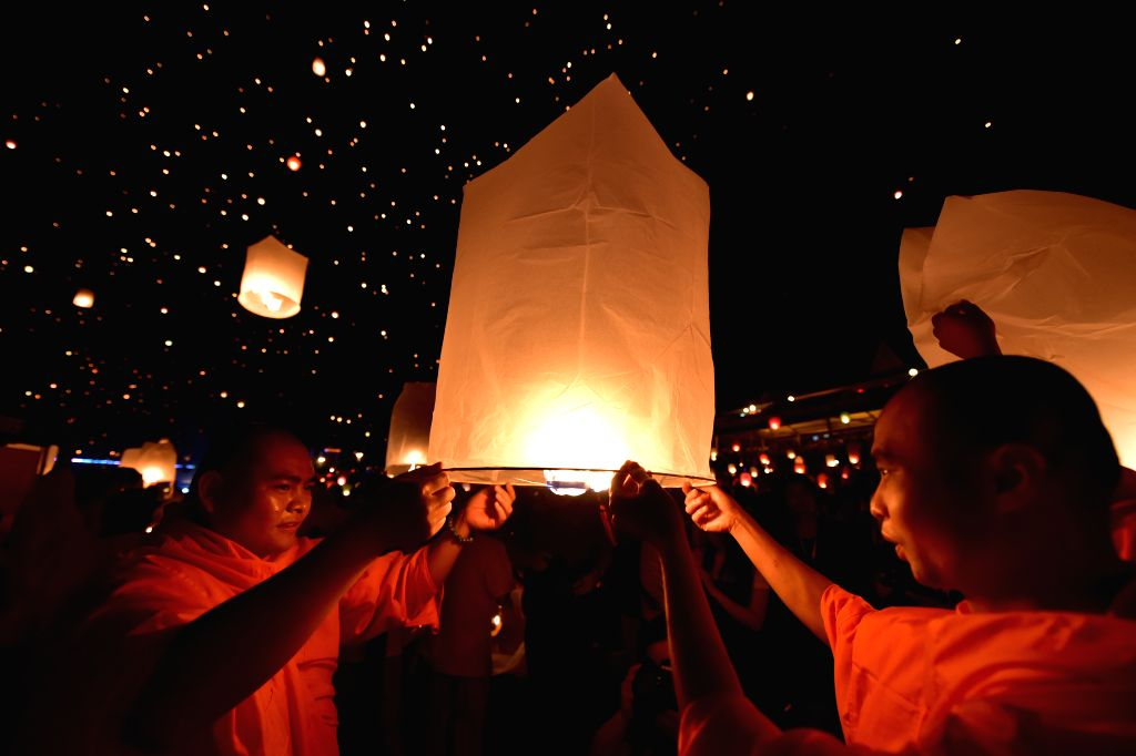 People fly Kongming lanterns, or small hot-air paper balloons, to celebrate the New Year of the Dai ethnic group in Jinghong City, Dai Autonomous Prefecture of ...