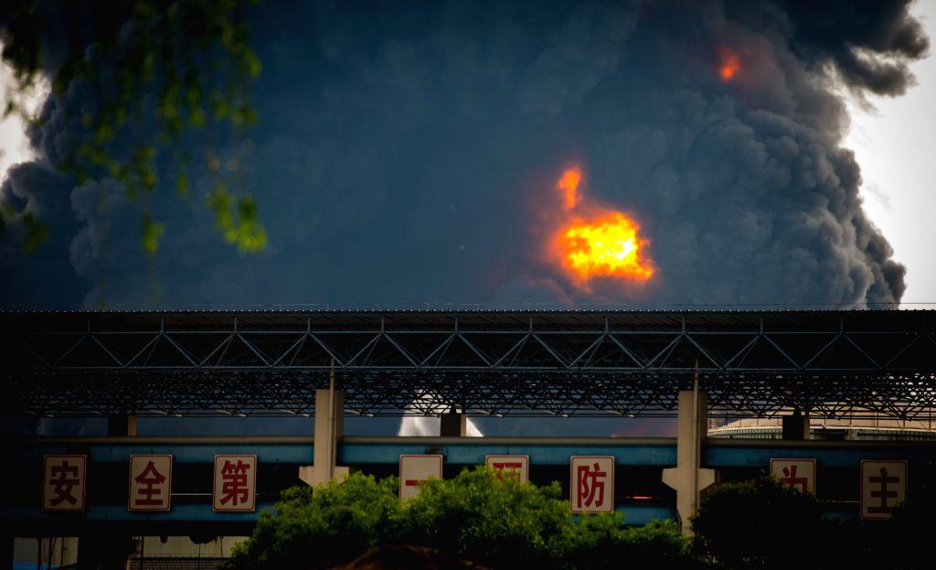 JINGJIANG, April 22, 2016 - Photo taken on April 22, 2016 shows the site where a fire occurred at the Jiangsu Deqiao Storage Co., Ltd.in Jingjiang City, east China's Jiangsu Province. A fire occurred ...