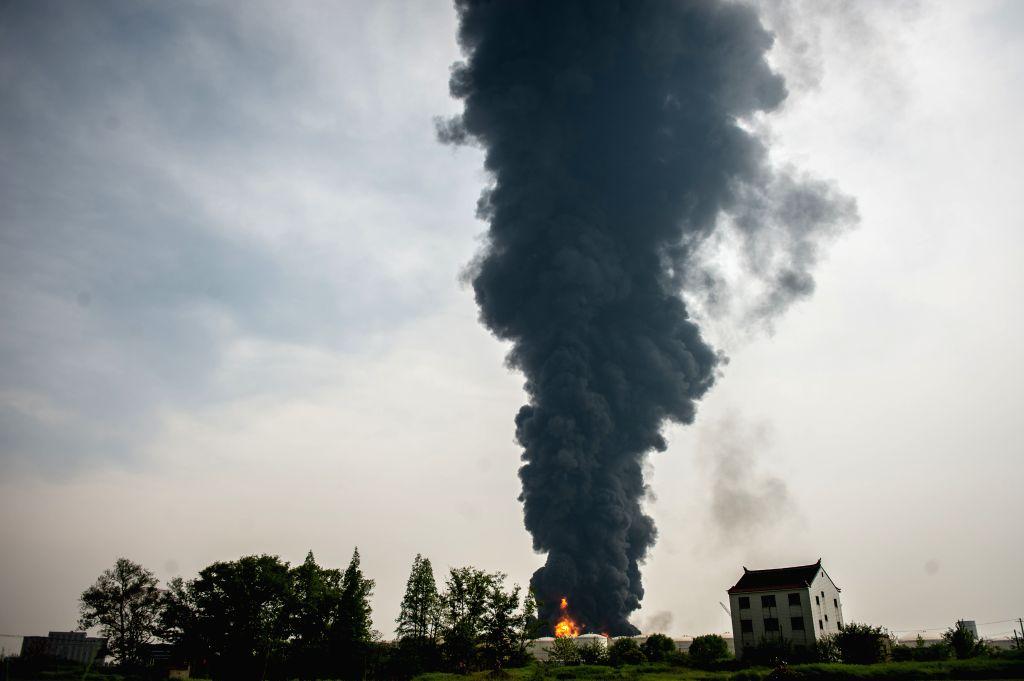 JINGJIANG, April 22, 2016 - Photo taken on April 22, 2016 shows smog billowing frow the site where a fire occurred at the Jiangsu Deqiao Storage Co., Ltd.in Jingjiang City, east China's Jiangsu ...