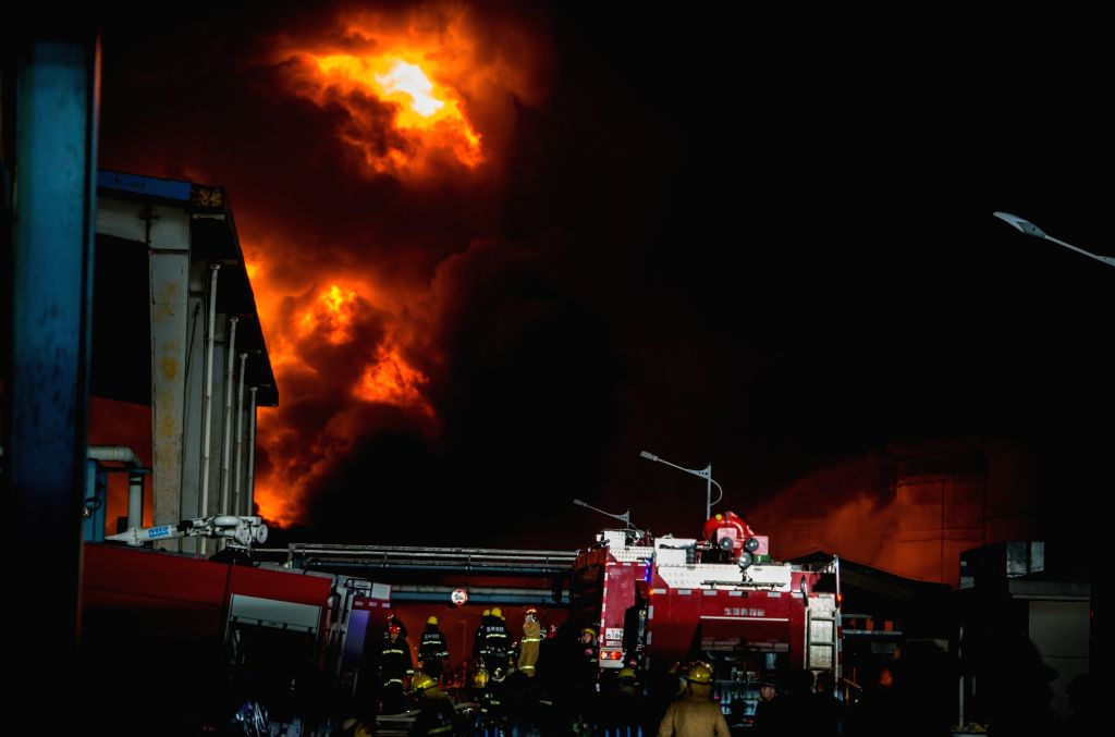 JINGJIANG, April 23, 2016 - Firefighters try to extinguish blaze at a chemical storage of Deqiao Storage Company in Jingjiang City, east China's Jiangsu Province, April 22, 2016. Blaze has been fully ...