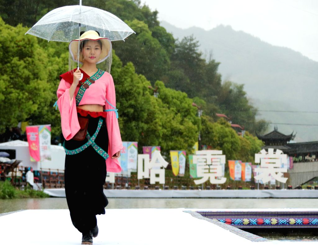 JINGNING, April 10, 2016 - A model shows a creation in the rain during the 3rd China She nationlality constume contest in Jingning She Autonomous County, east China's Zhejiang Province, April 9, 2016
