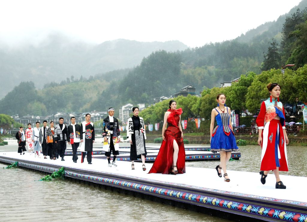 JINGNING, April 10, 2016 - Models show creations in the rain during the 3rd China She nationlality constume contest in Jingning She Autonomous County, east China's Zhejiang Province, April 9, 2016