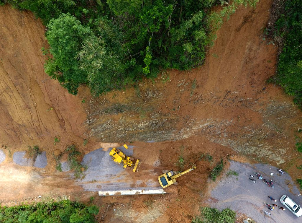 JINXIU, Sept. 19, 2018 - In this aerial photo taken on Sept. 19, 2018,  workers clear a road damaged by Super Typhoon Mangkhut in Liuxiang Village of the Yao Autonomous County of Jinxiu in south ...