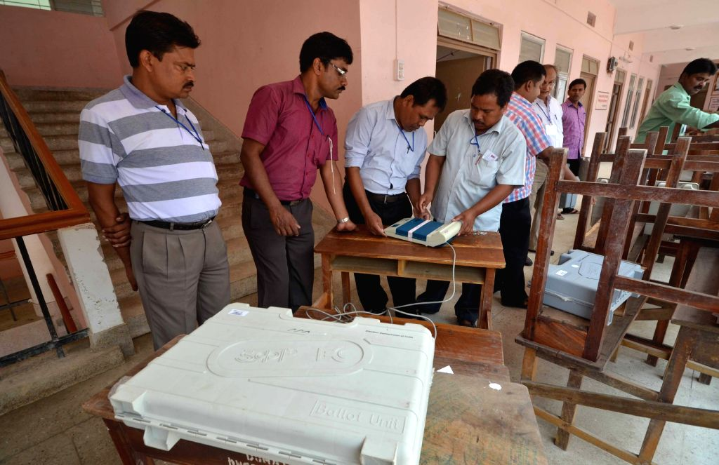 Polling personnel inspect Electronic Voting Machines before leaving for their respective booths at a EVM distribution centre in Jirania, near Agartala, on May 2, 2015.