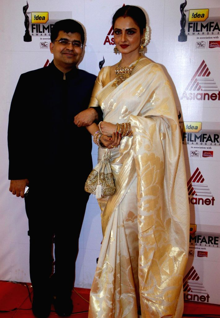Jitesh Pillaai & Rekha at the `61st Idea Filmfare South Awards 2013` held in Chennai at Nehru Stadium. - Rekha