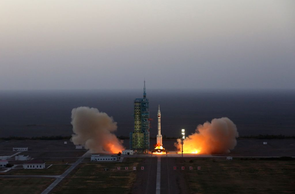 JIUQUAN, Oct. 17, 2016 - The Long March-2F carrier rocket carrying China's Shenzhou-11 manned spacecraft blasts off from the launch pad at the Jiuquan Satellite Launch Center in Jiuquan, northwest ...