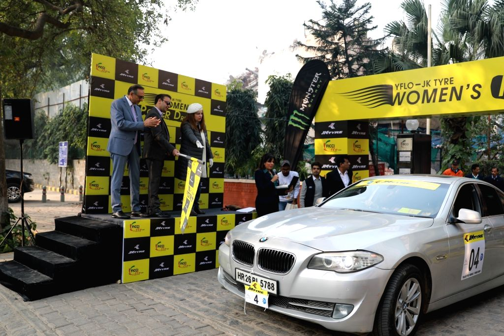 JK Industries Director Srivats Singhania, FMSCI and Women in Motorsport (WIM) Chairperson Sita Raina and JK Tyres Marketing Director Vikram Malhotra, flag off the 'Women's Power Drive ... - Vikram Malhotra