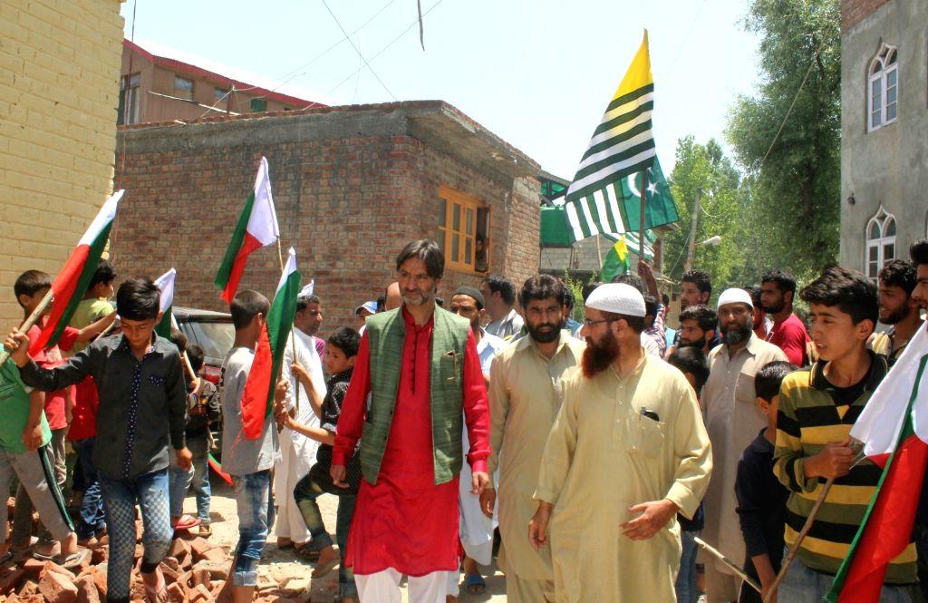 JLKF chairman Muhammad Yasin Malik leads a rally in Noon Bagh area of Srinagar on June 4, 2017. - Malik