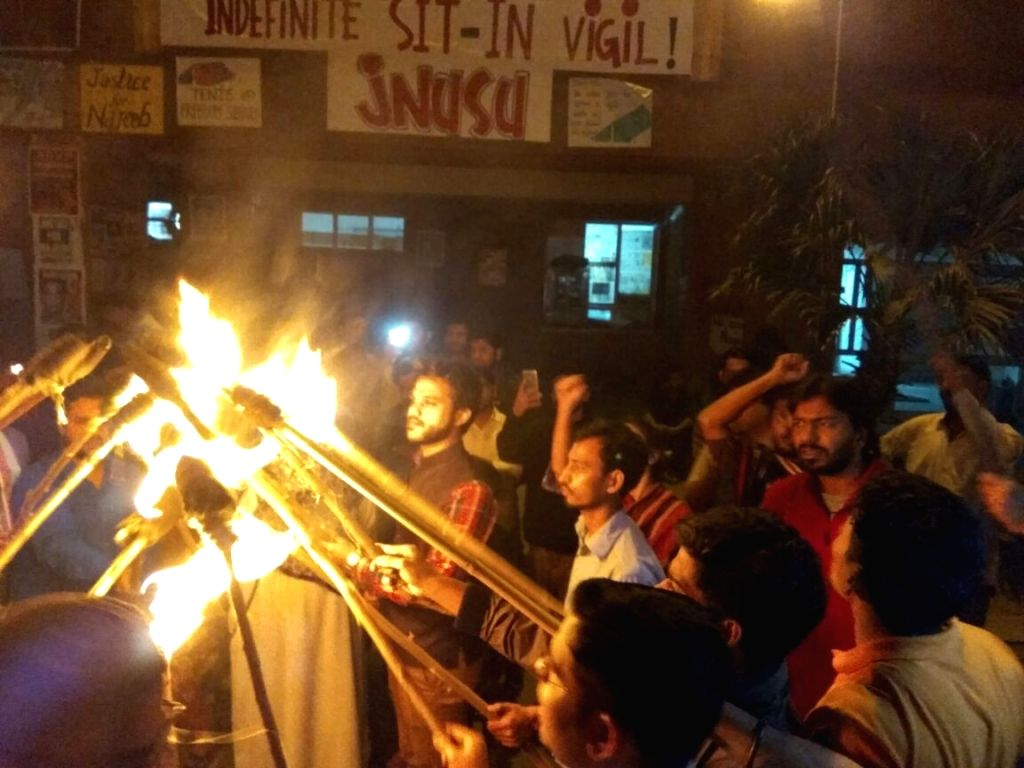 JNU students participate in Light a Ray of Hope for Najeeb - a symbolic protest organised for the safe return of Ahmed, who was brually assaulted by an at least 20-strong mob of students ...