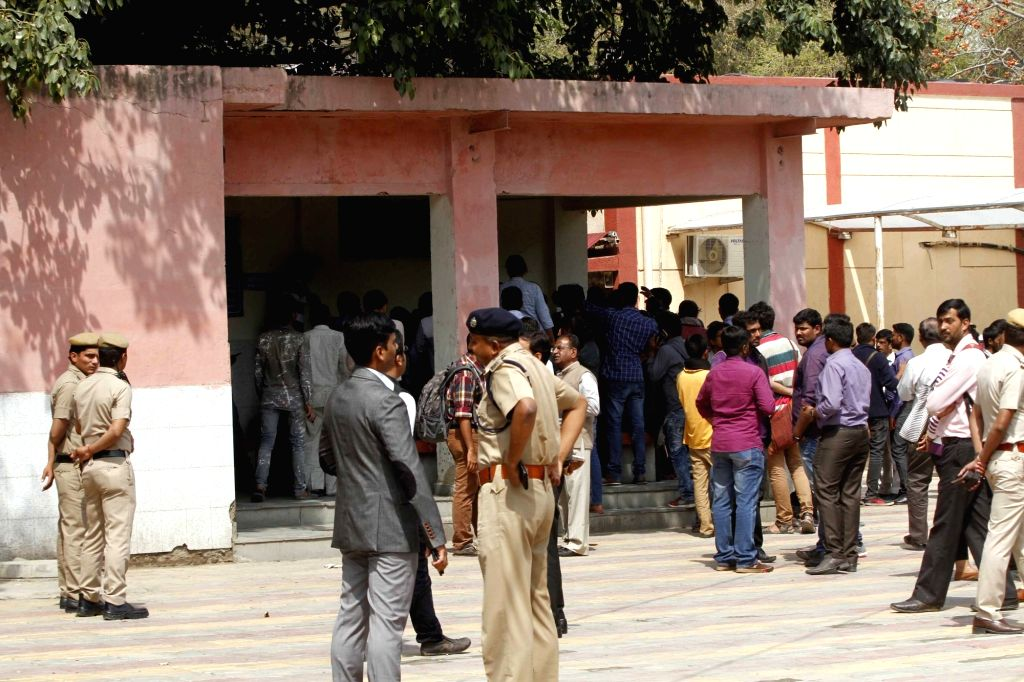 JNU students wait outside the All India Institute of Medical Sciences for the post-mortem report of J Muthukrishnan, an M.Phil student of JNU who allegedly hanged himself to death in his ...
