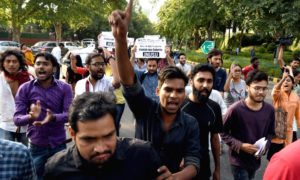JNUSU members shout slogans against Home Minister Rajnath Singh over the disappearance of Najeeb Ahmed, who has been missing for the past seven days. in New Delhi on Oct 21, 2016. - Rajnath Singh