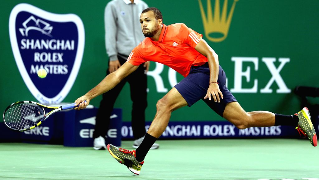 Jo-Wilfried Tsonga of France hits a return to Rafael Nadal of Spain during their semifinal match at the Shanghai Masters tennis tournament in Shanghai, east China, ...